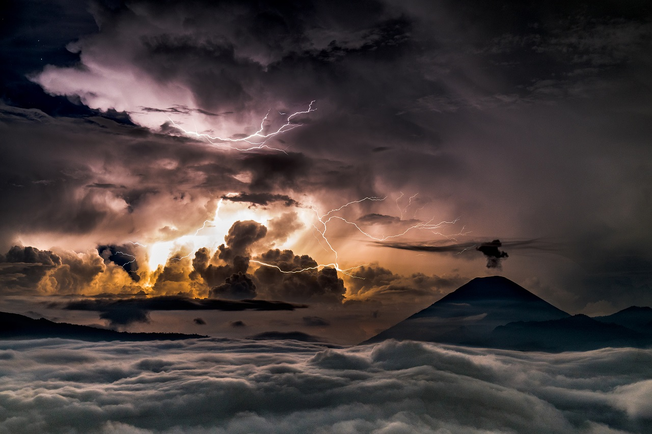 A strong storm with lightning in the raging sea