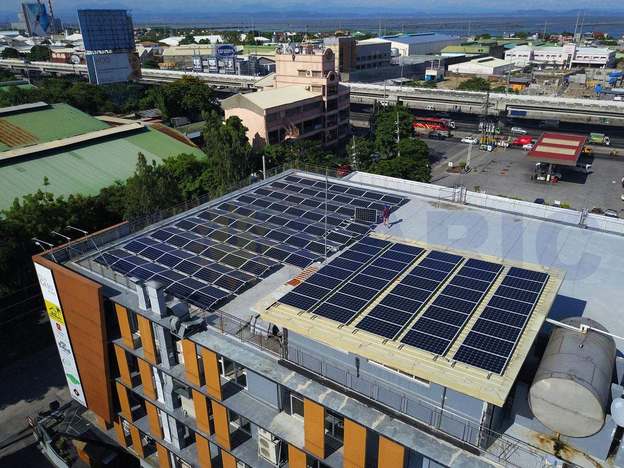 Don Gesu Building in Alabang, Philippines with solar panels on its roof