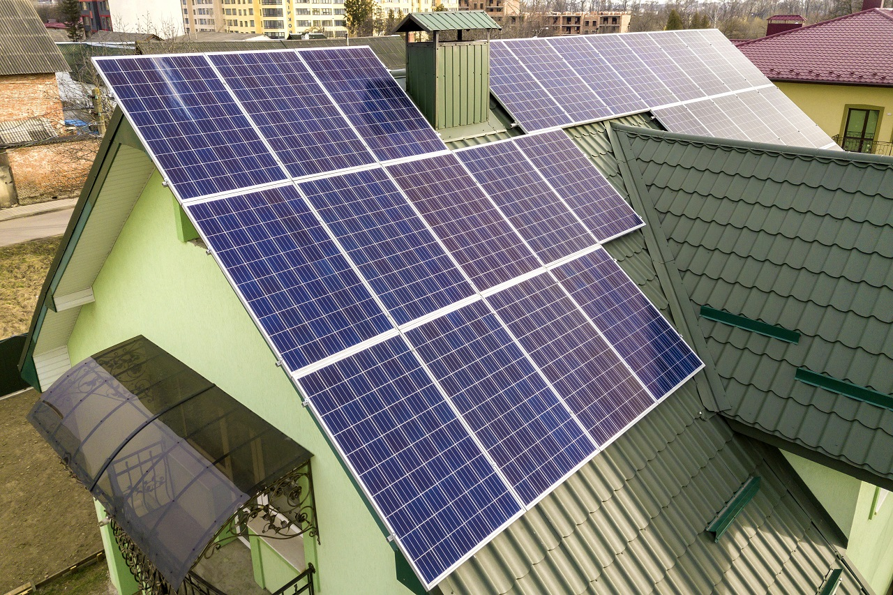 Top view of a green house with solar panels on the roof
