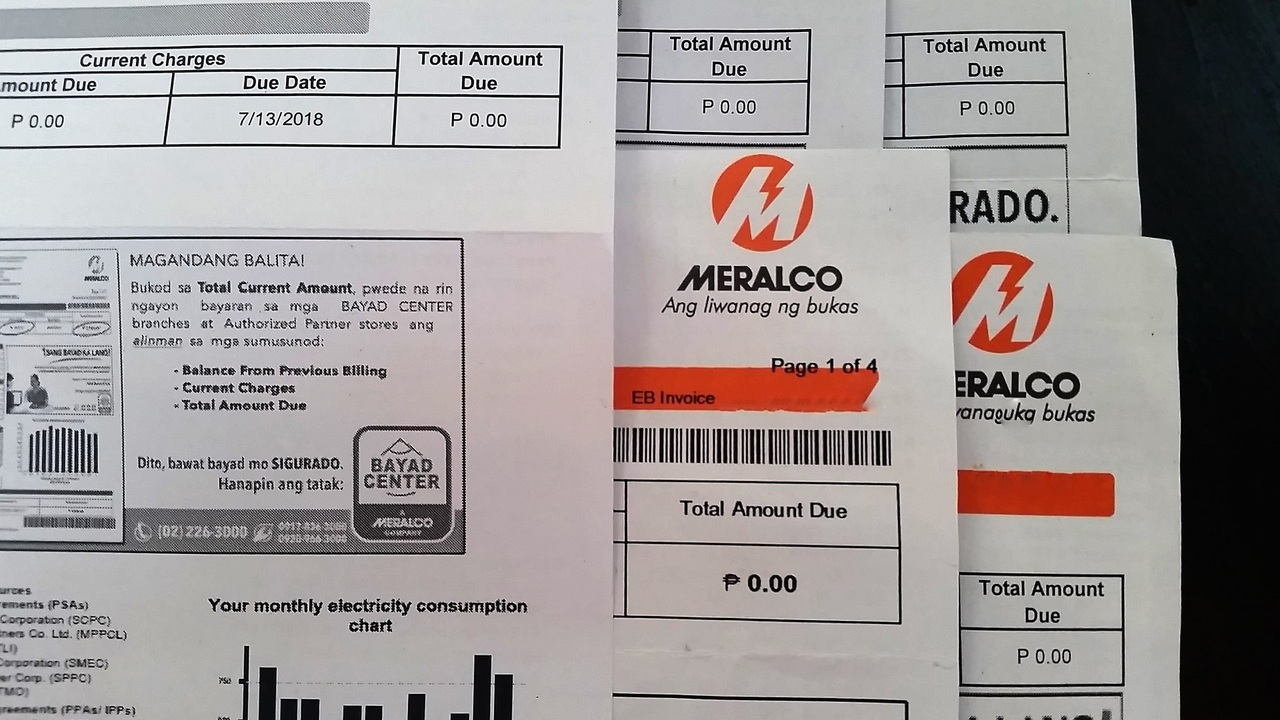 Close up of electricity bills in its envelopes