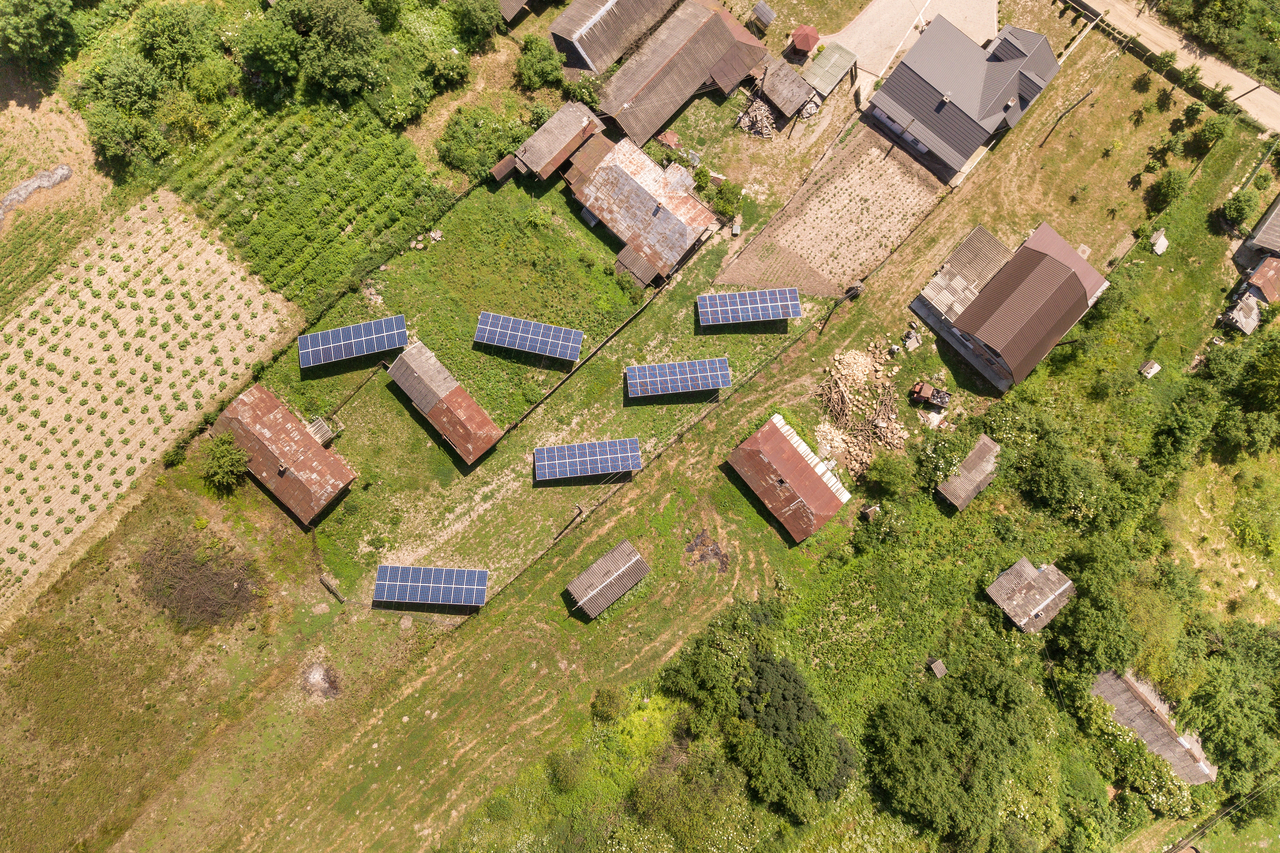 Extreme top shot of houses in a rural area with solar panels