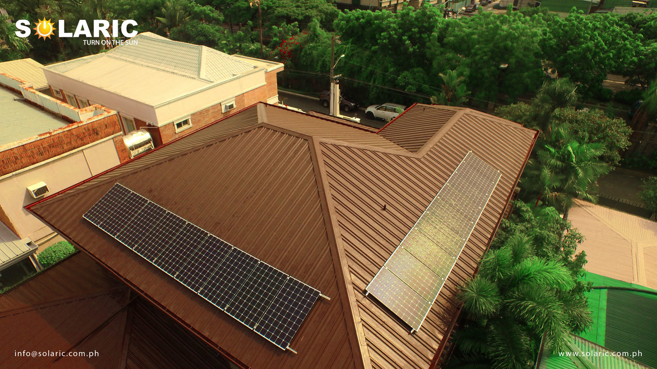Top view of a house with solar roofing