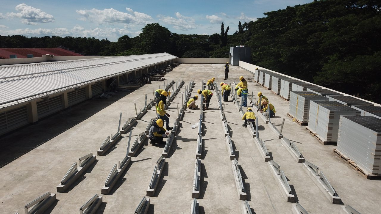 A team installing solar on a rooftop