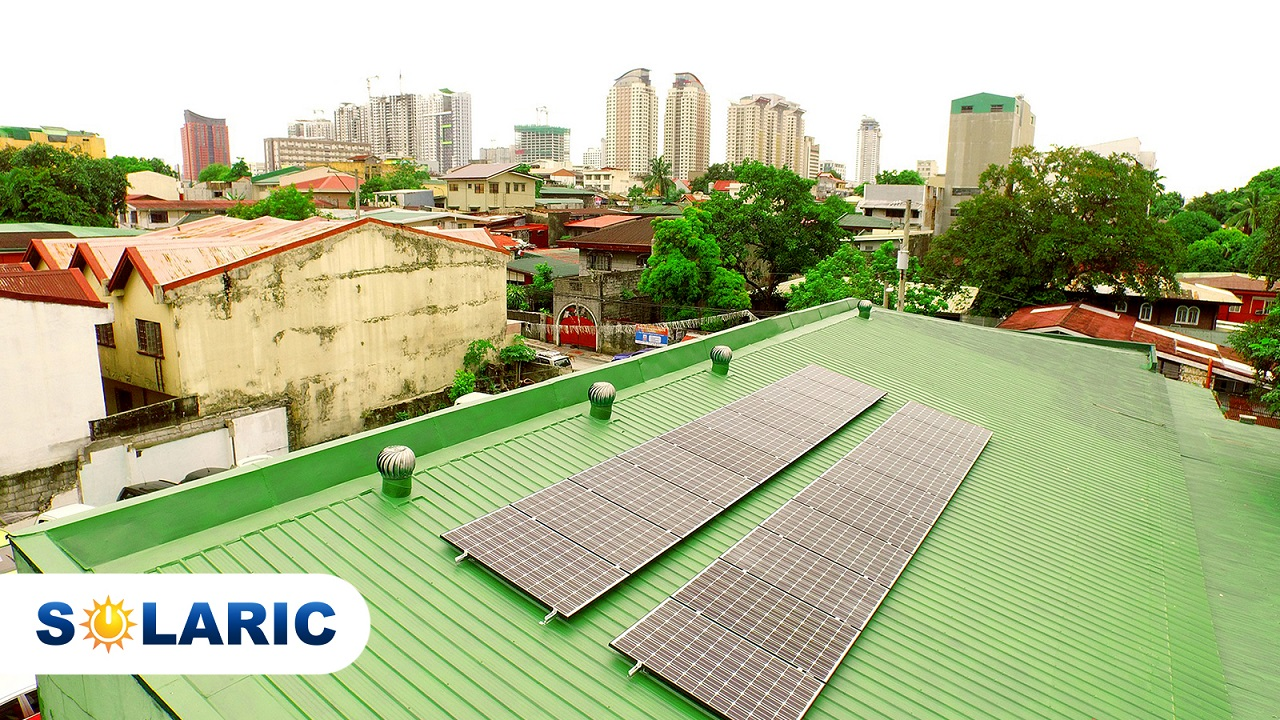 Solaric solar panels on a green rooftop