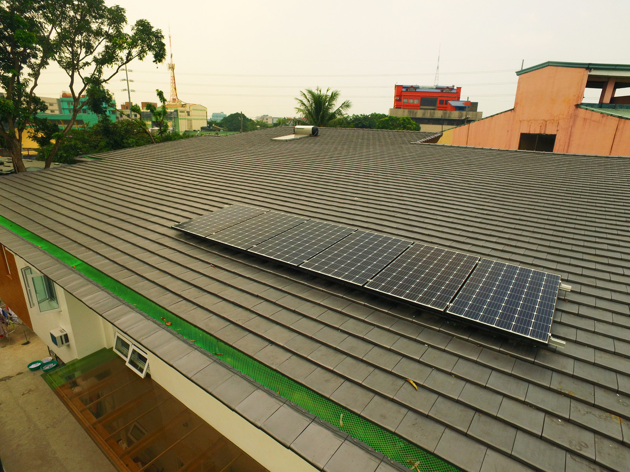 Shot of a home's roof with solar panels