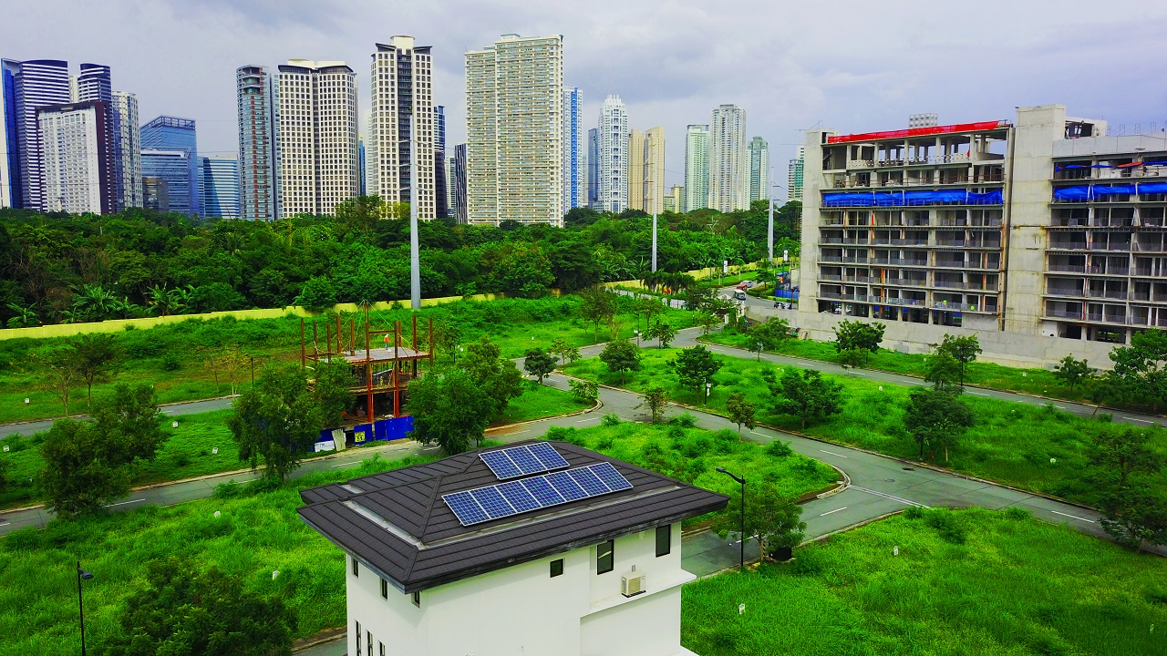 Top view of a building with solar amidst a city