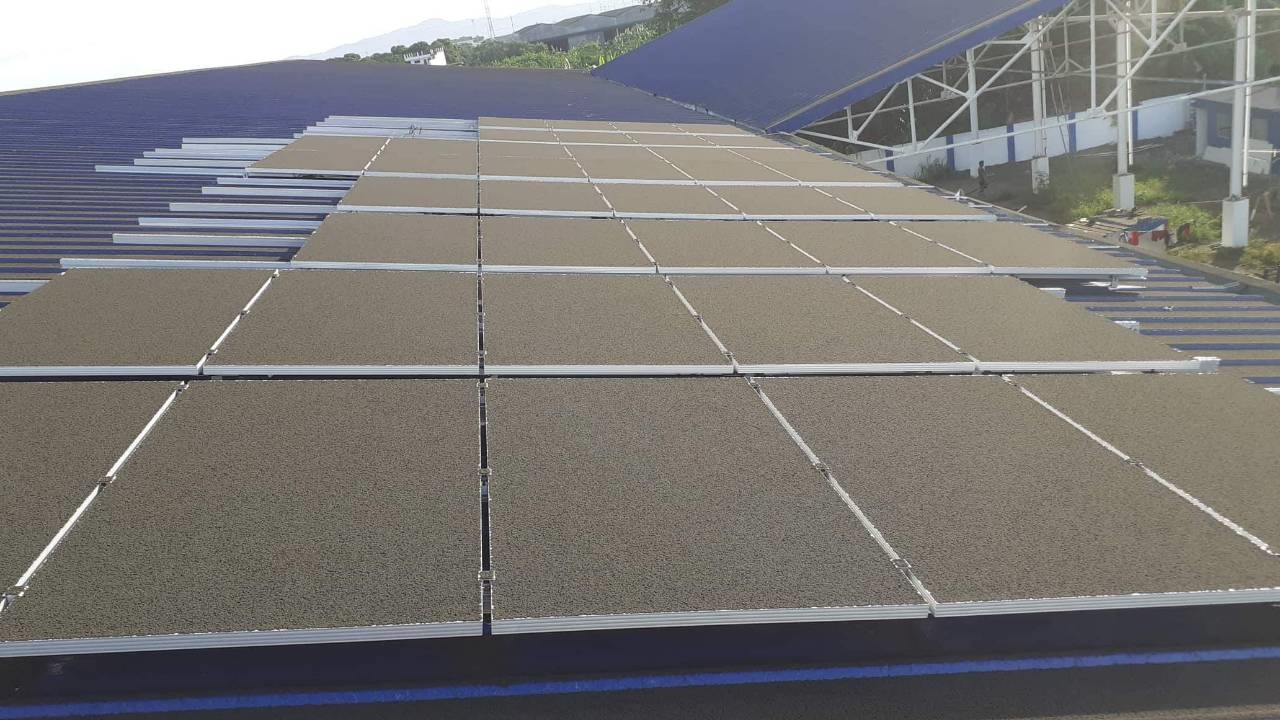 Solar panels completely covered in volcanic ash