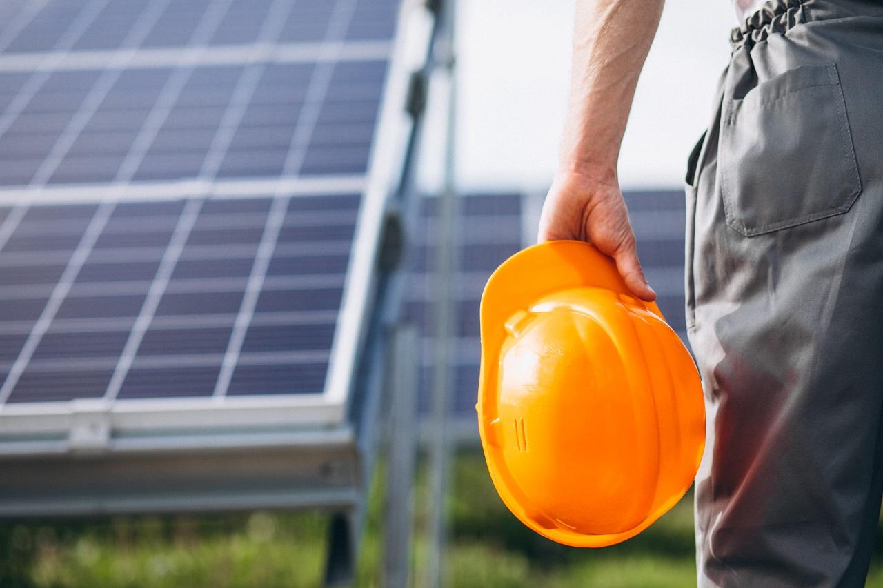 A worker installing solar panels
