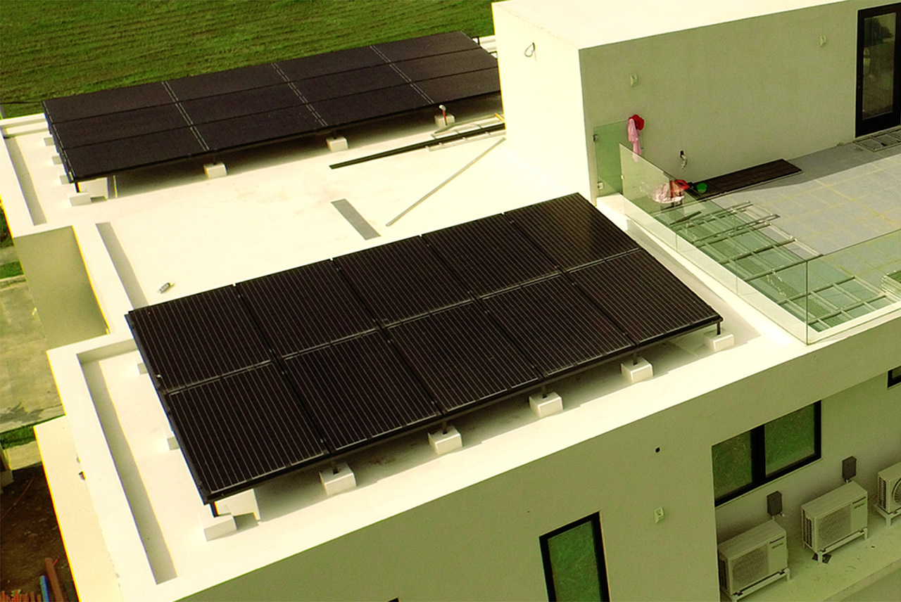 Solar panels on top of a house with a small rooftop