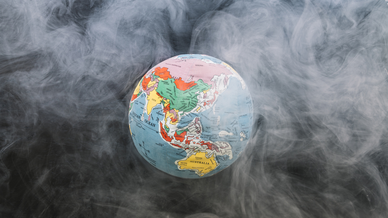 A globe of the Earth surrounded by smoke pollution