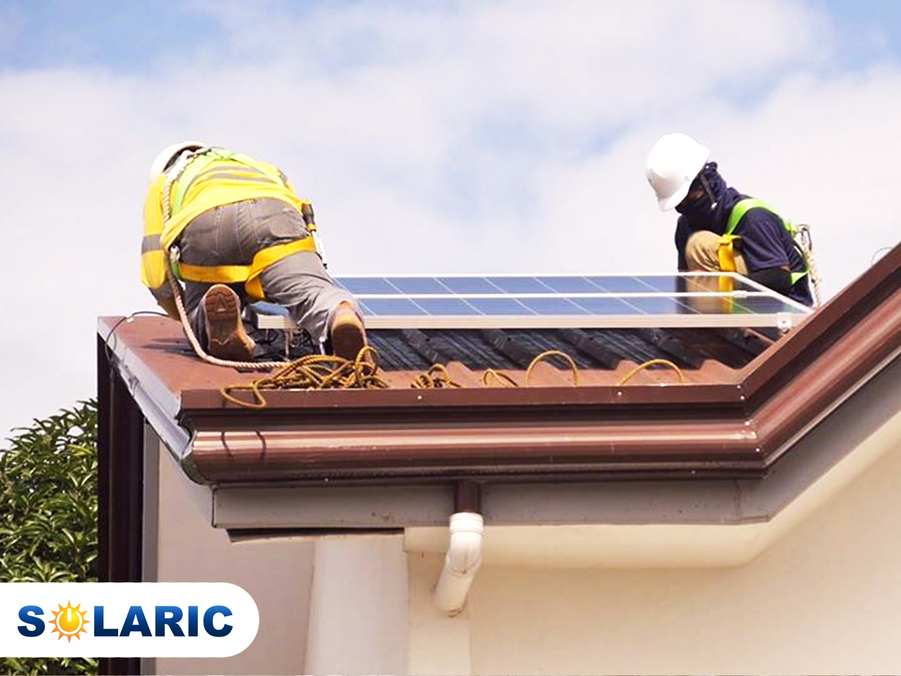 Solaric workers installing solar roofing