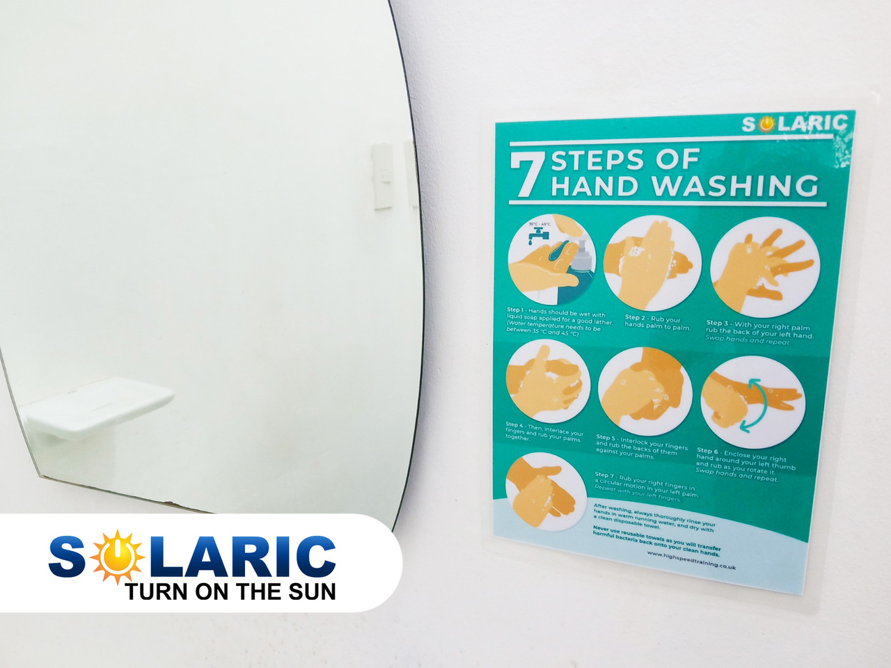 An infographic stuck to a bathroom wall on how to wash hands