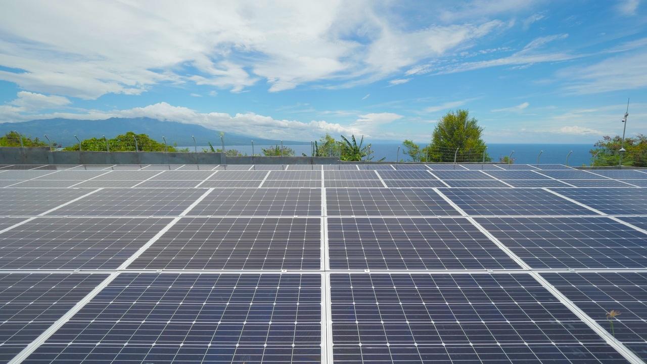 The blue sky over solar panels
