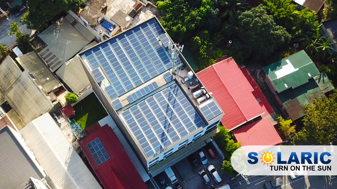 Top shot of a house with rooftop solar panels