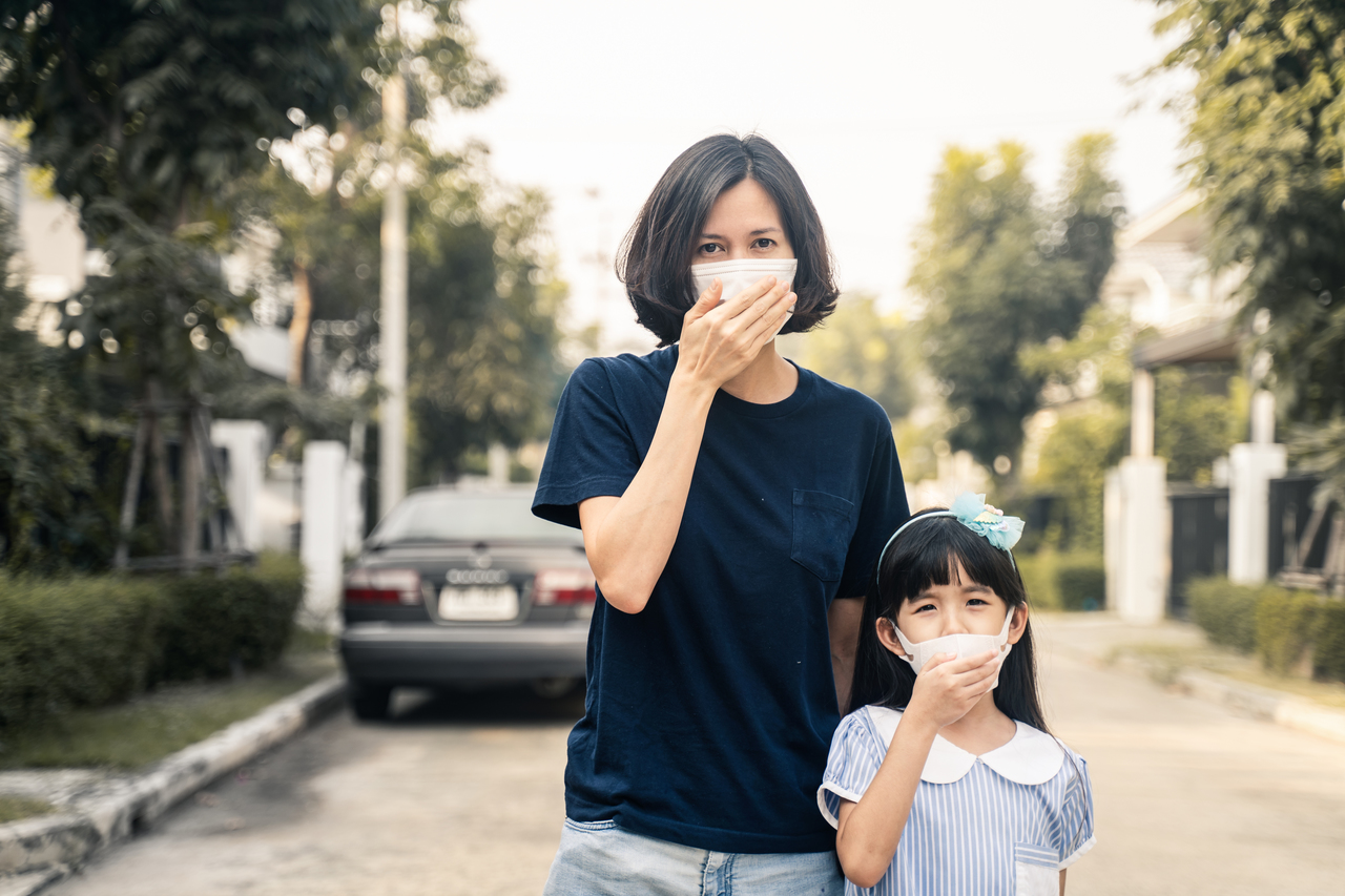 A woman and her daughter wearing face masks