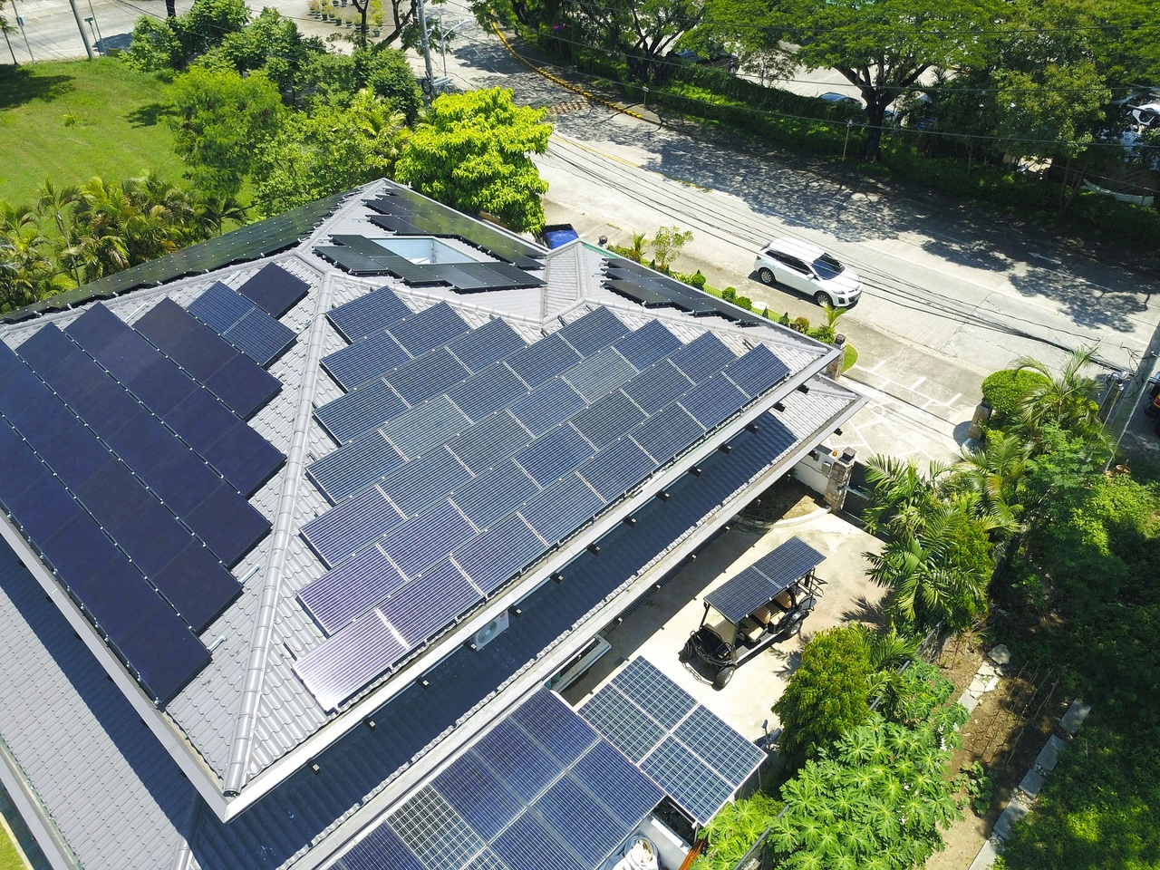 Top shot of a home with solar panels on its rooftop