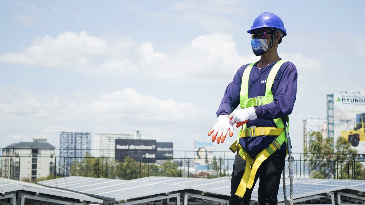 A Solaric worker in a new PPE