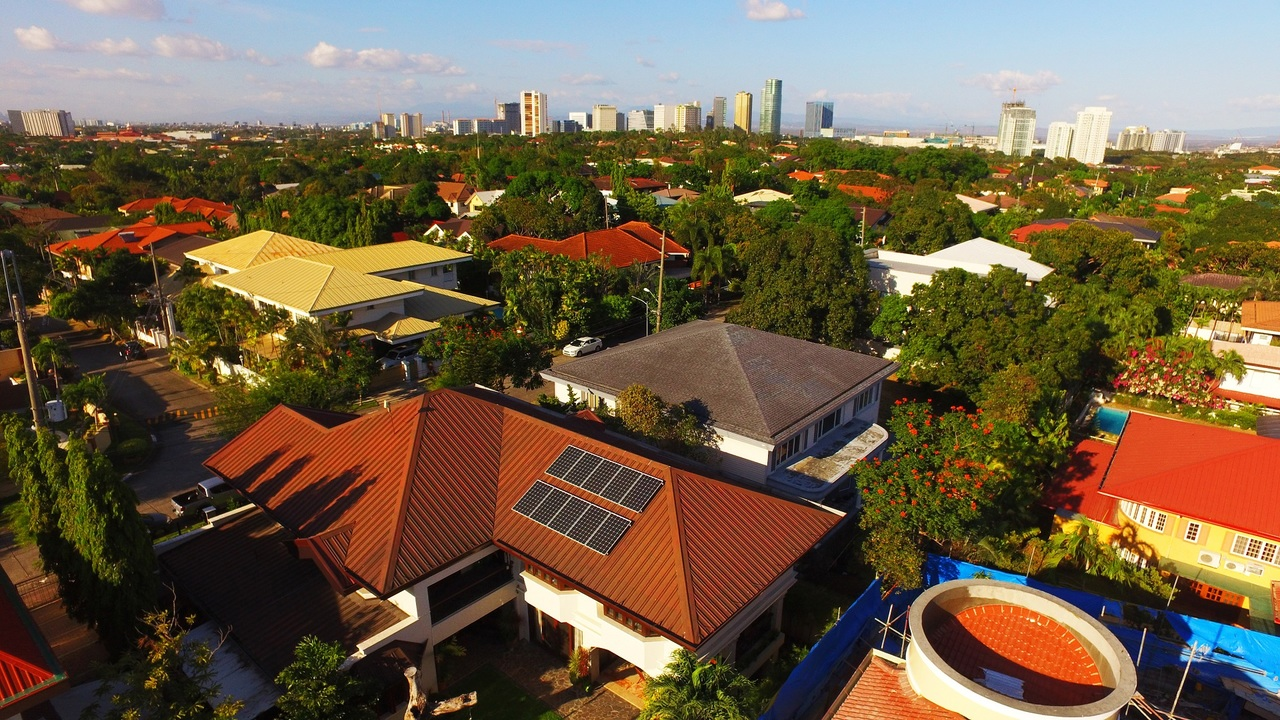 Overview of a village with rooftop solar panels