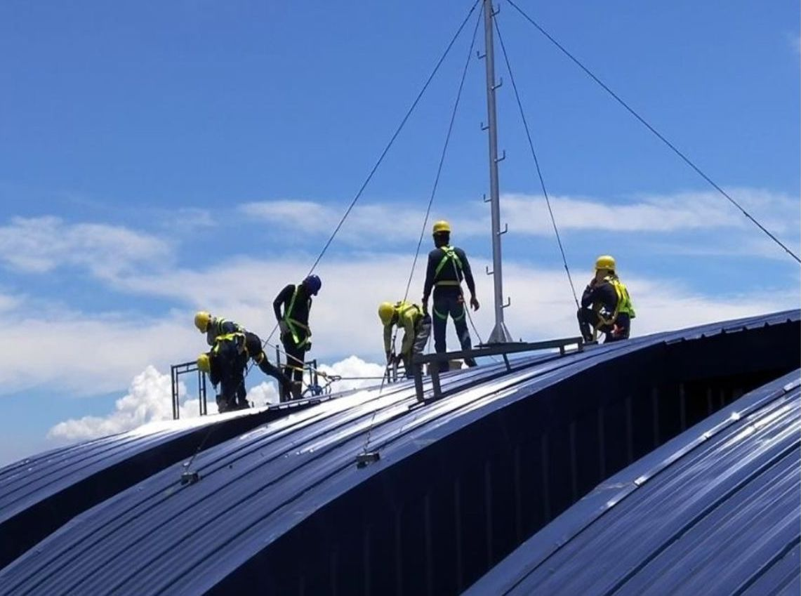 Solar experts installing solar panels on a roof