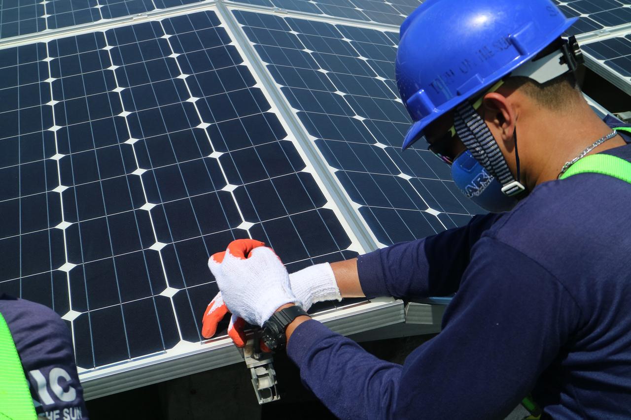 Solar expert installing solar grid
